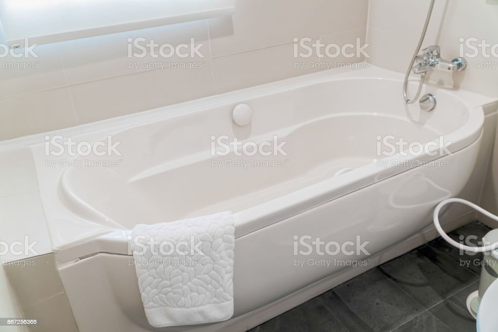Fragment of a luxury bathroom with a detail of bathtub stock photo
