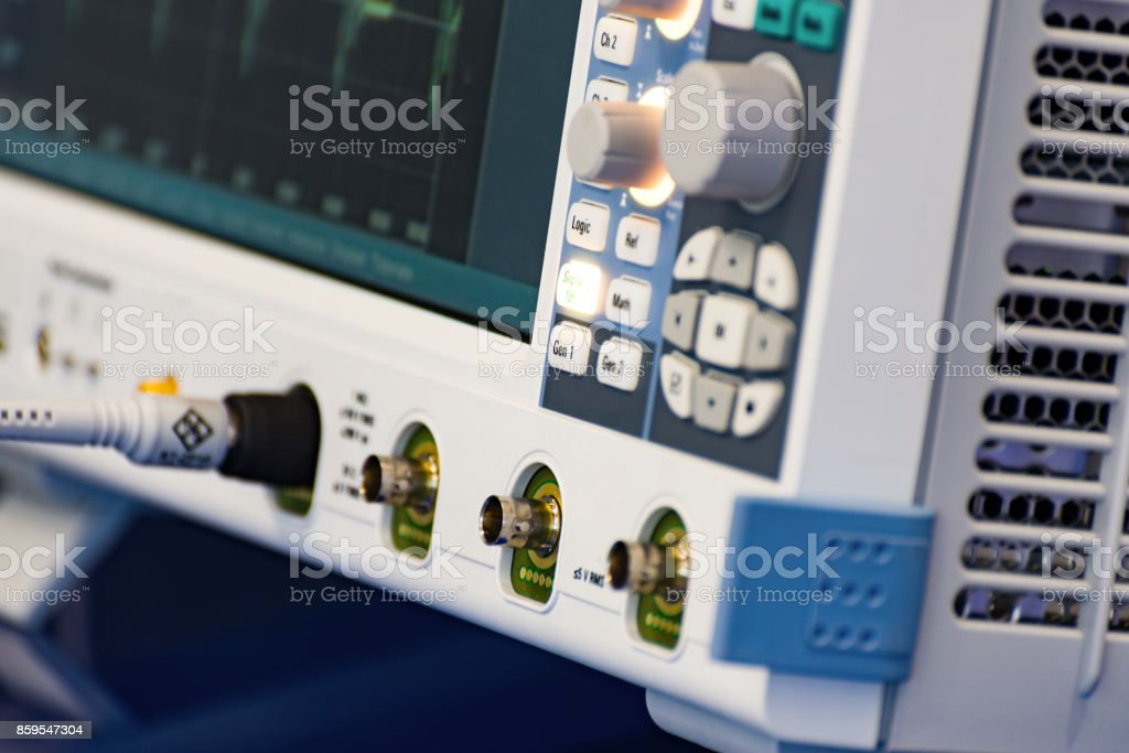 Fragment of a modern digital oscilloscope. Scientific measuring equipment stock photo