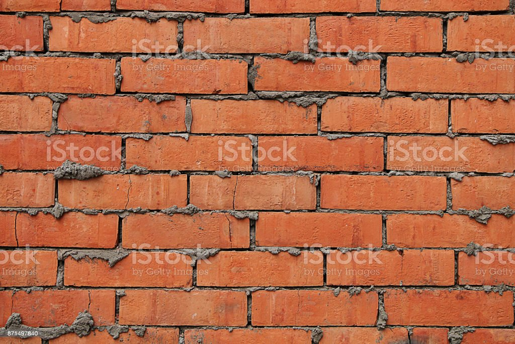 Fragment of a new, newly built brick wall stock photo