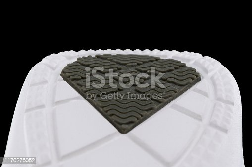 Fragment of a rubber gray-white sole of a sneaker. Bottom of sports shoes