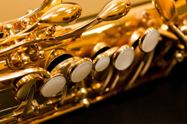 fragment of a saxophone valves - altsaxophon stock-fotos und bilder