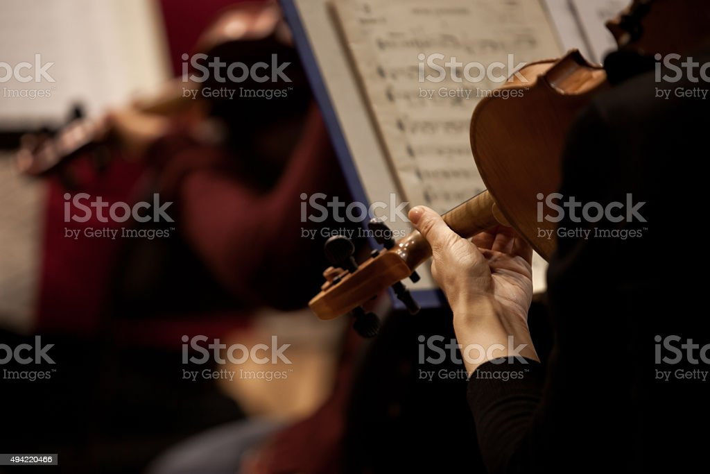 Fragment of a violin in the hands of a musician stock photo