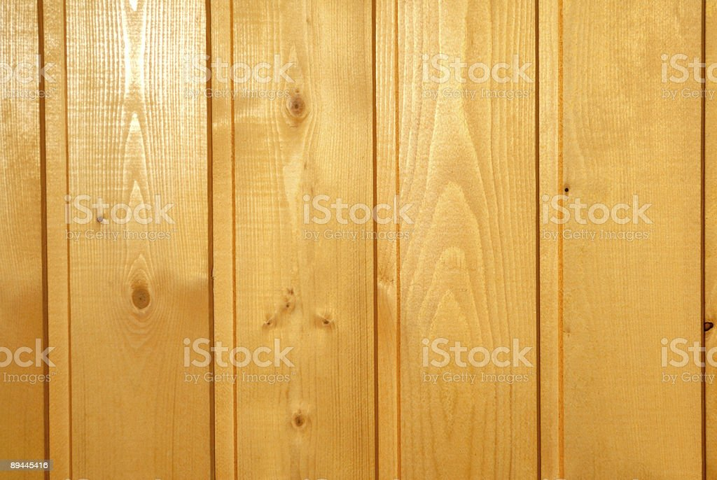 Fragment of a wall revetted with wooden boards royalty-free stock photo
