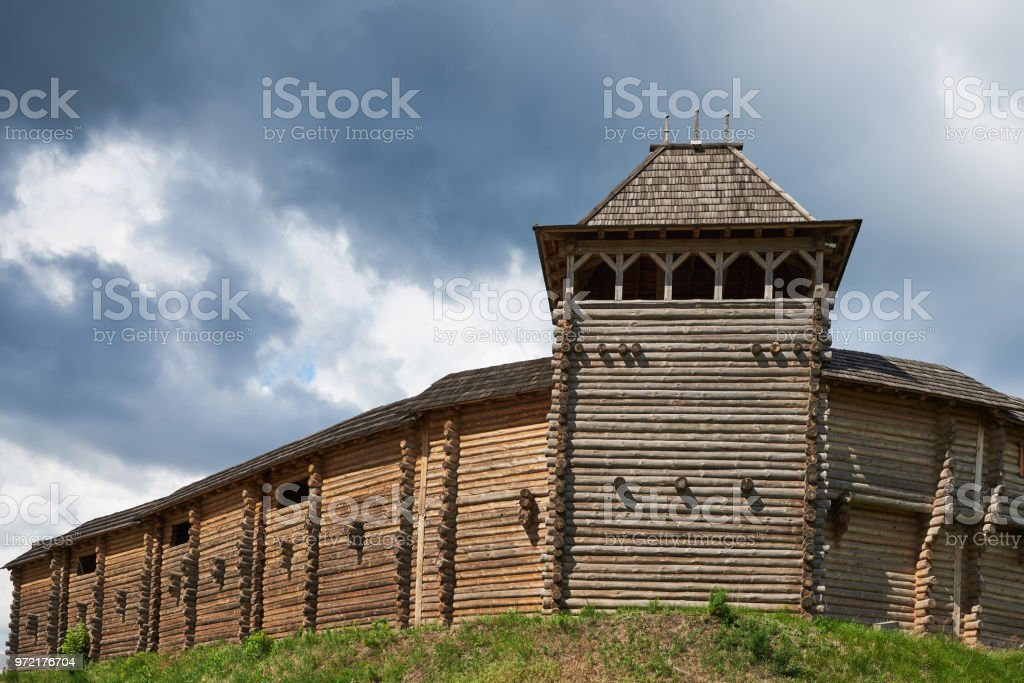 Fragment of a wooden fortress with a tower and a wall. Reconstruction of the fortress of the eleventh century, which is located in Ukraine, Kiev region, village Kopachov stock photo