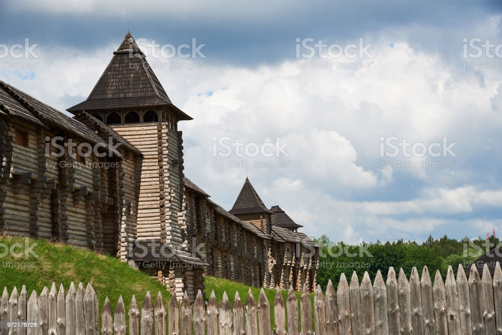 Fragment of a wooden fortress with towers, a wall and a palisade. Reconstruction of the fortress of the eleventh century, which is located in Ukraine, Kiev region, village Kopachov stock photo