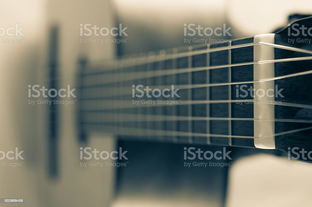 fragment of acoustic guitar. Processing in vintage style stock photo