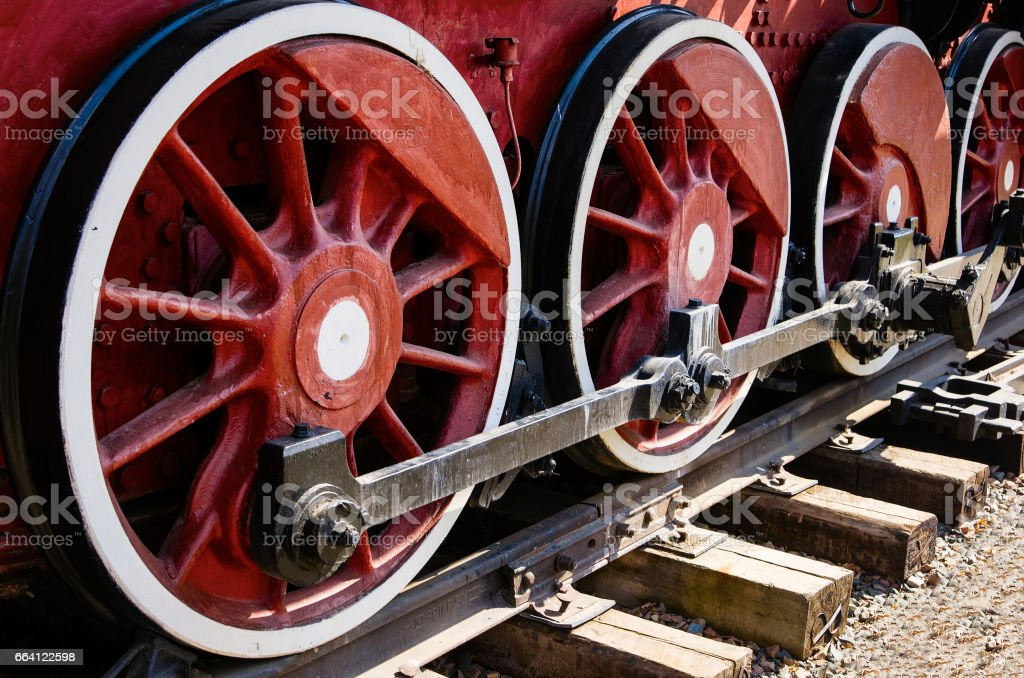 Fragment of an old steam locomotive running gear foto stock royalty-free