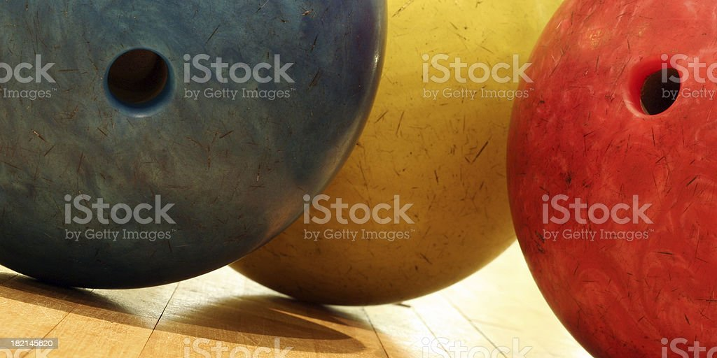 A set of coloured bowling ballssimilar images :