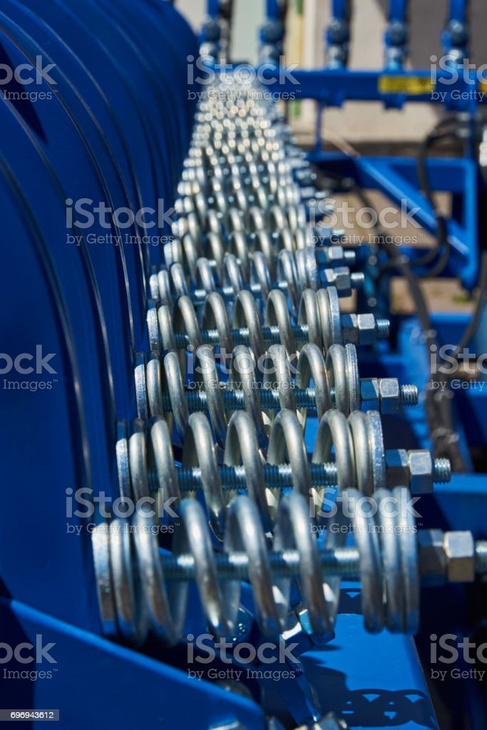 Fragment of cultivator with spring shock absorbers stock photo