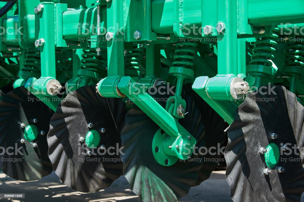 Fragment of cultivator with working disks and spring shock absorbers stock photo