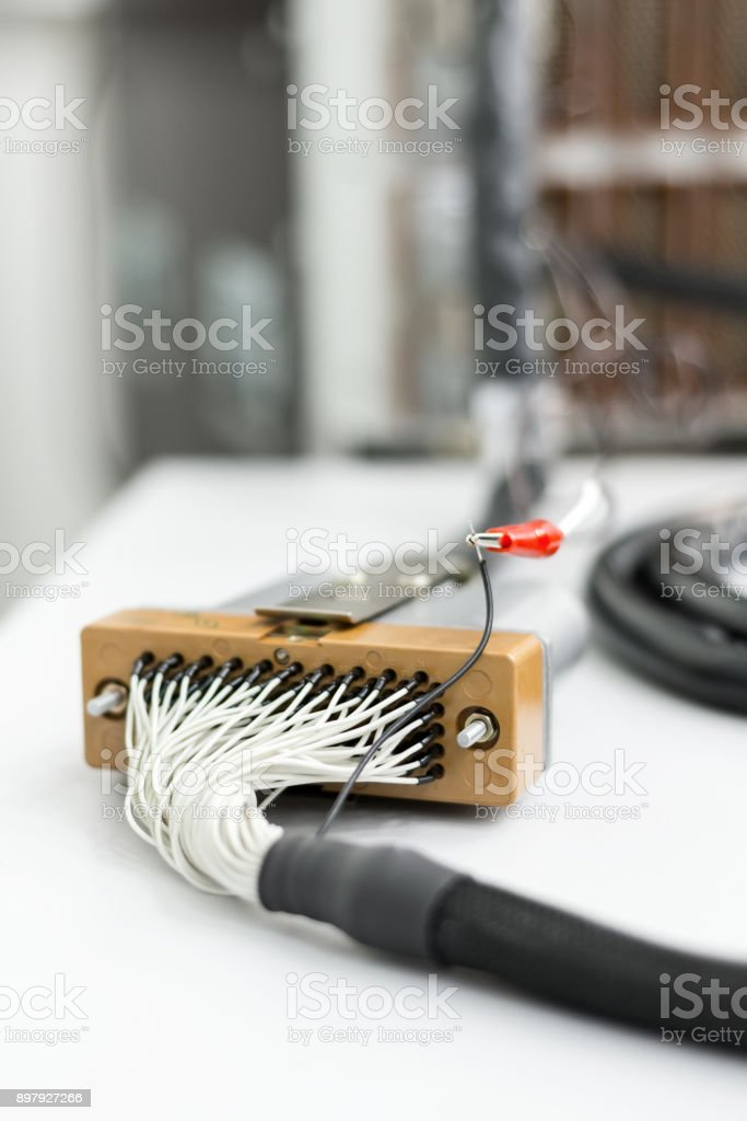 Fragment of electrical cable with rectangular multi-pin connector stock photo