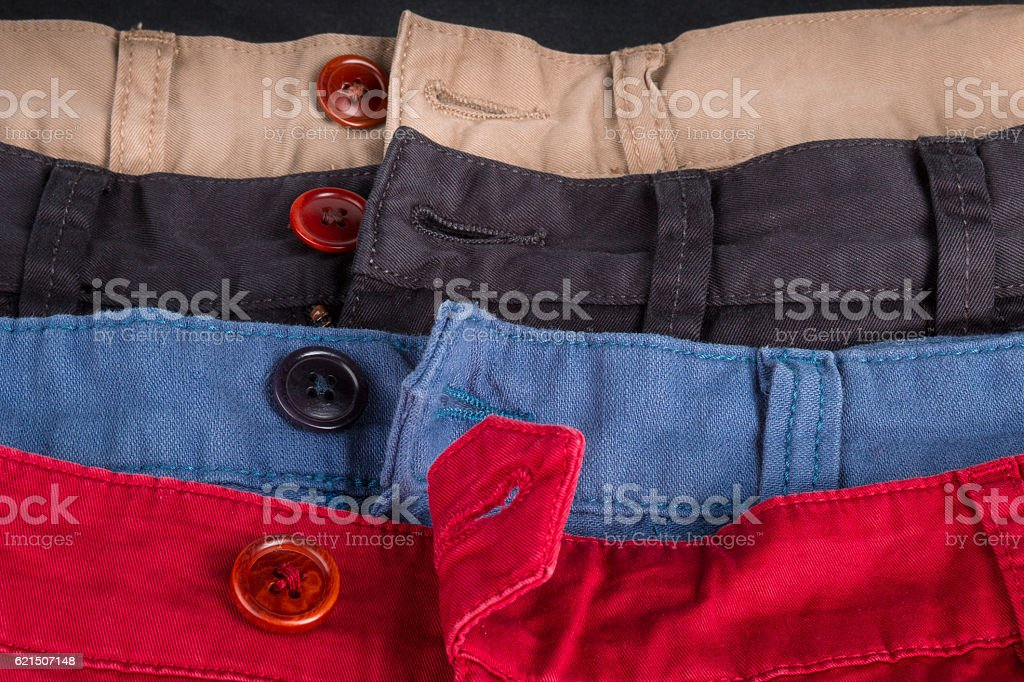 Fragment of four cotton twill pants red, blue, black, beige photo libre de droits