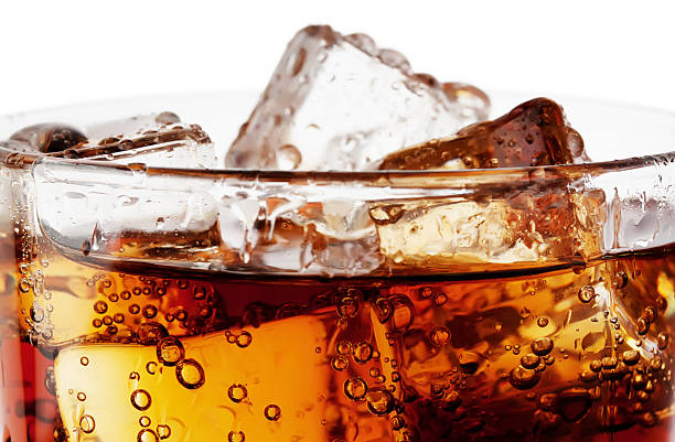 fragment of glass cola with ice - soda pop stock photos and pictures