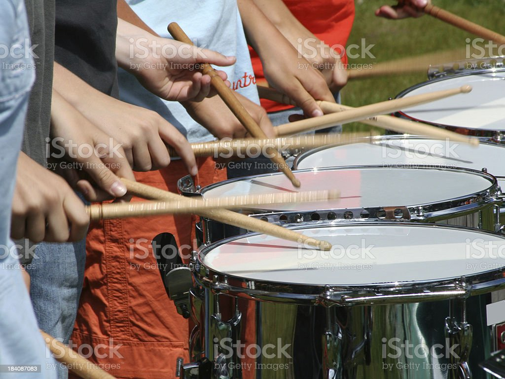 Fragment of kids drumming outdoor with shallow DOF stock photo