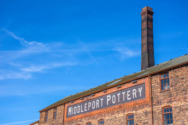 Fragment of Middleport pottery factory on bank of Trent and Mersey canal.19th century historic industrial architecture.Blue sky in background and copy space. stock photo