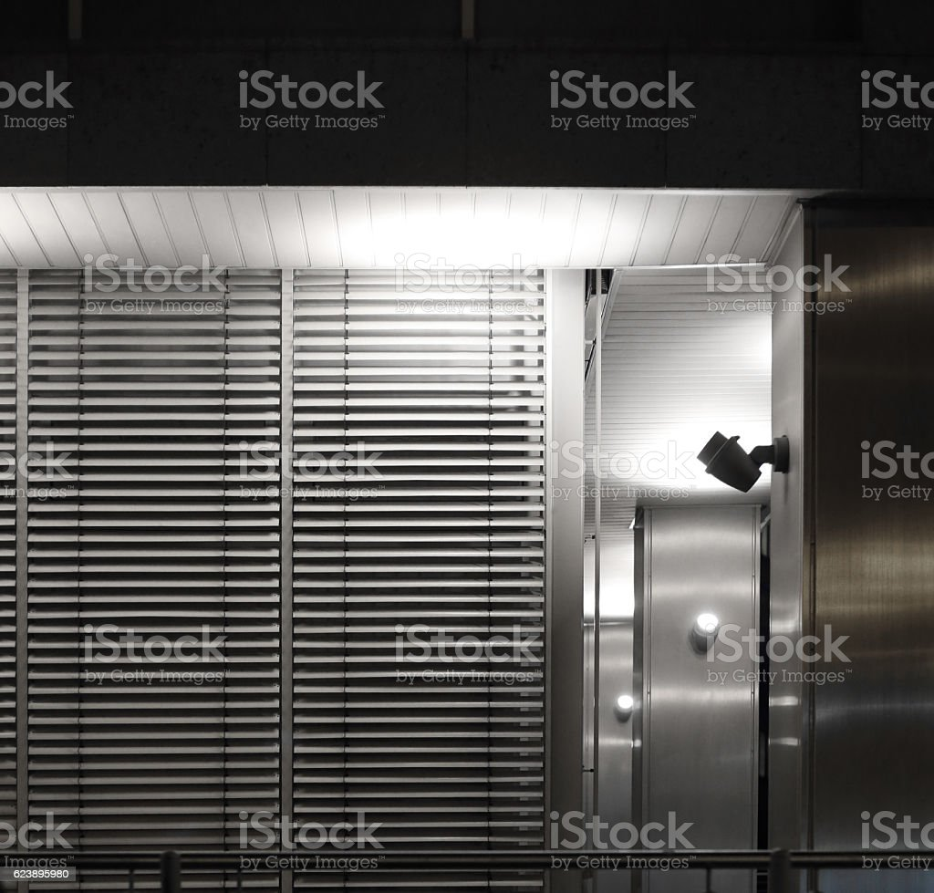 Fragment of modern architecture with jalousie / blinds / shutters stock photo
