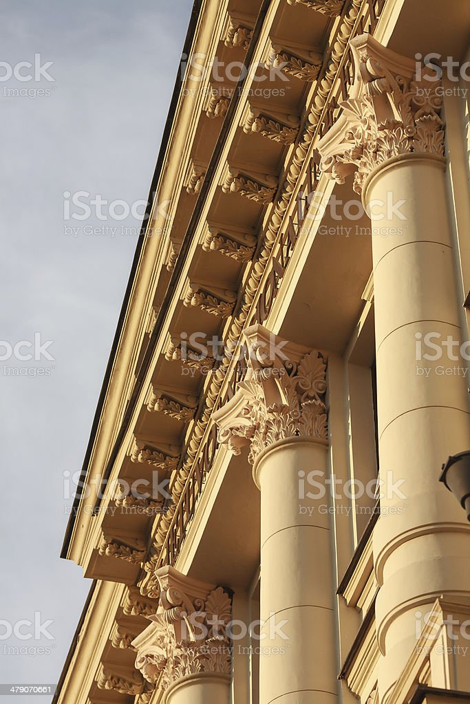 Fragment of neoclassic building with columns and fine capitals. stock photo