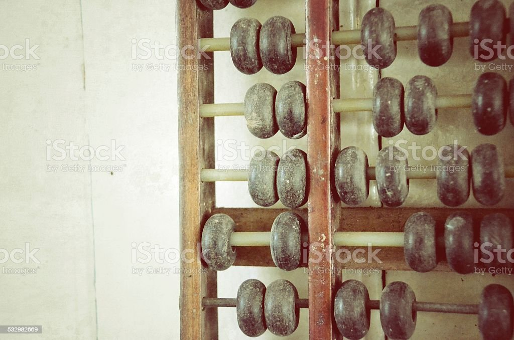 Fragment of old abacus close up stock photo