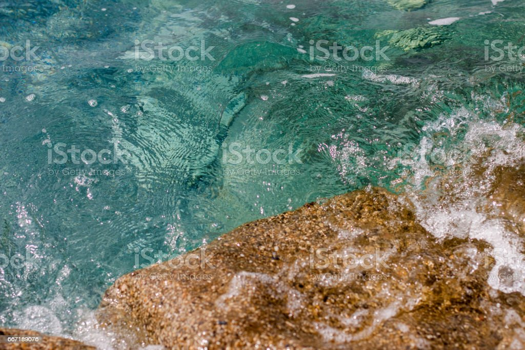 Fragment of pristine turquoise sea water stock photo