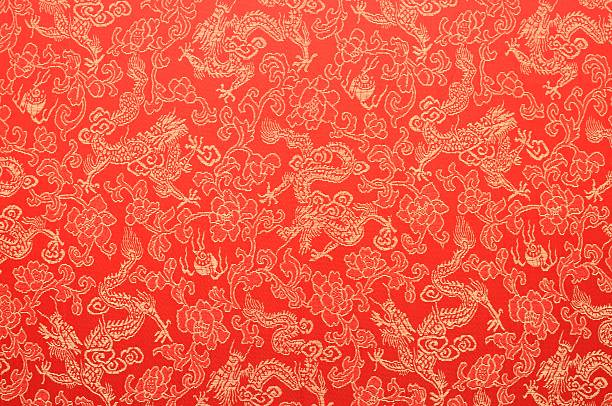 fragment of red chinese silk with golden dragons and flowers - chinese cultuur stockfoto's en -beelden