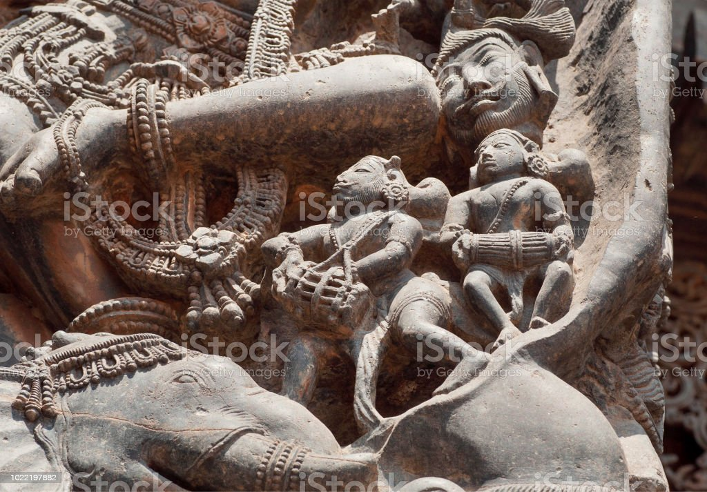 Fragment of stone carved relief with musicians under legs of Shiva. 12th century South Indian temple. Halebidu heritage, India stock photo