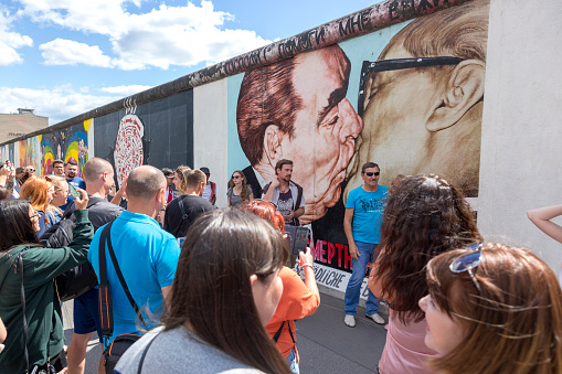 Fragment of the Berlin Wall with a drawing of the kiss of Brezhnev and Honneker