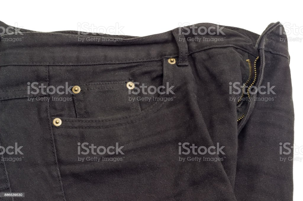 Fragment of the black jeans on white background stock photo