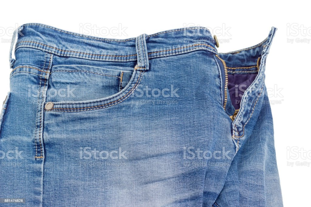 Fragment of the blue jeans on a white background stock photo