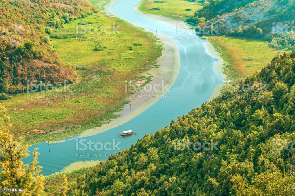 Fragment of the curve of the Crnojevica River in the National Park of Lake Skadar, Montenegro. stock photo