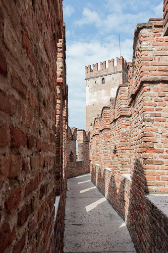 Verona, Italy - September 26, 2015 : Fragment of the fortress wall and watchtower in Castelvecchio castle in Verona, Italy