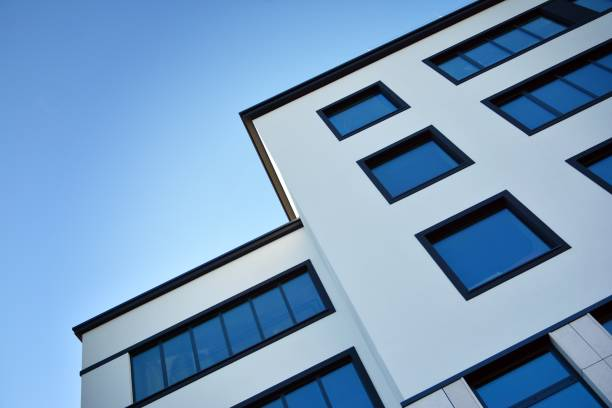 Fragment of the glass facade of office building stock photo