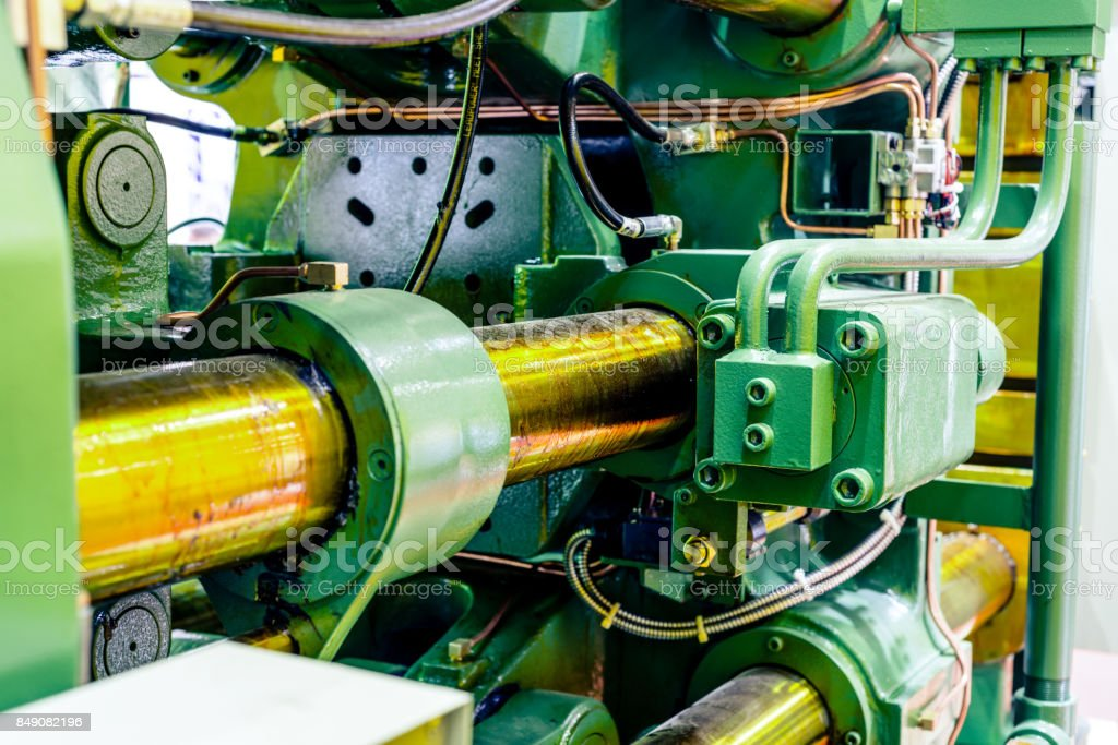 Fragment of the injection molding machine stock photo
