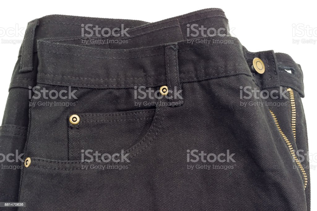 Fragment of the new black jeans on white background stock photo