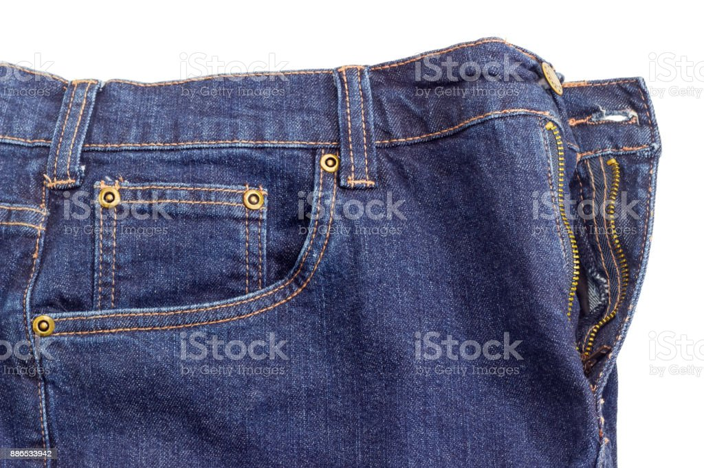Fragment of the new dark blue jeans on white background stock photo