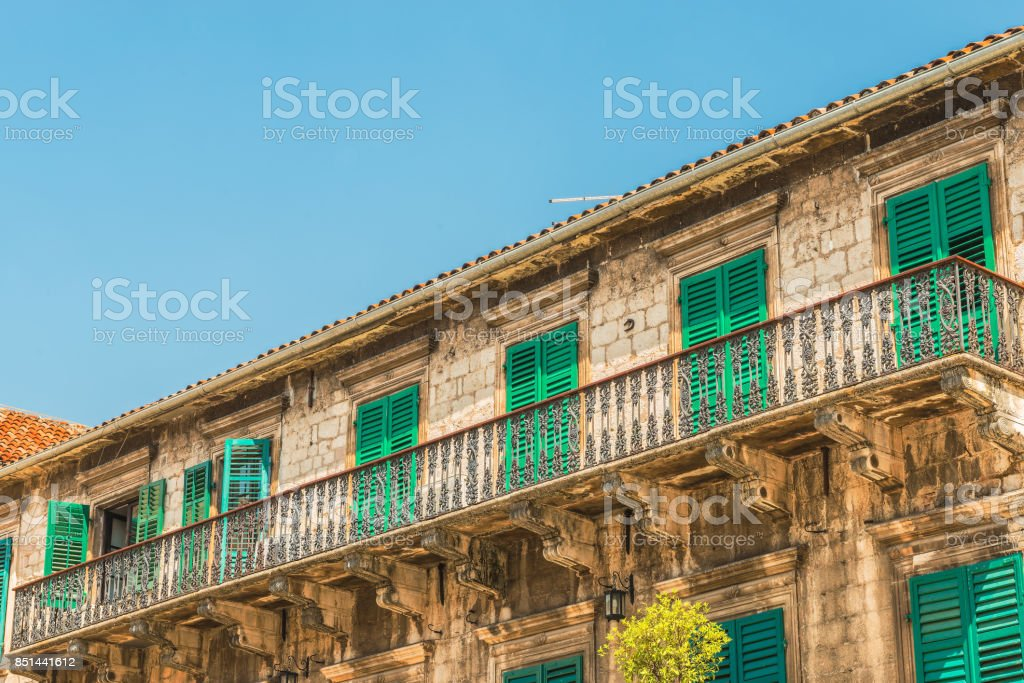 Fragment (forged balcony) of the palace of Pima (XVII century) in the Old City, Kotor, Montenegro. Now there are various exhibitions. stock photo