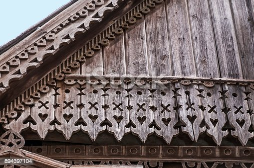 Fragment of the pediment of the old Russian wooden house of the times of the old Russian Empire.
