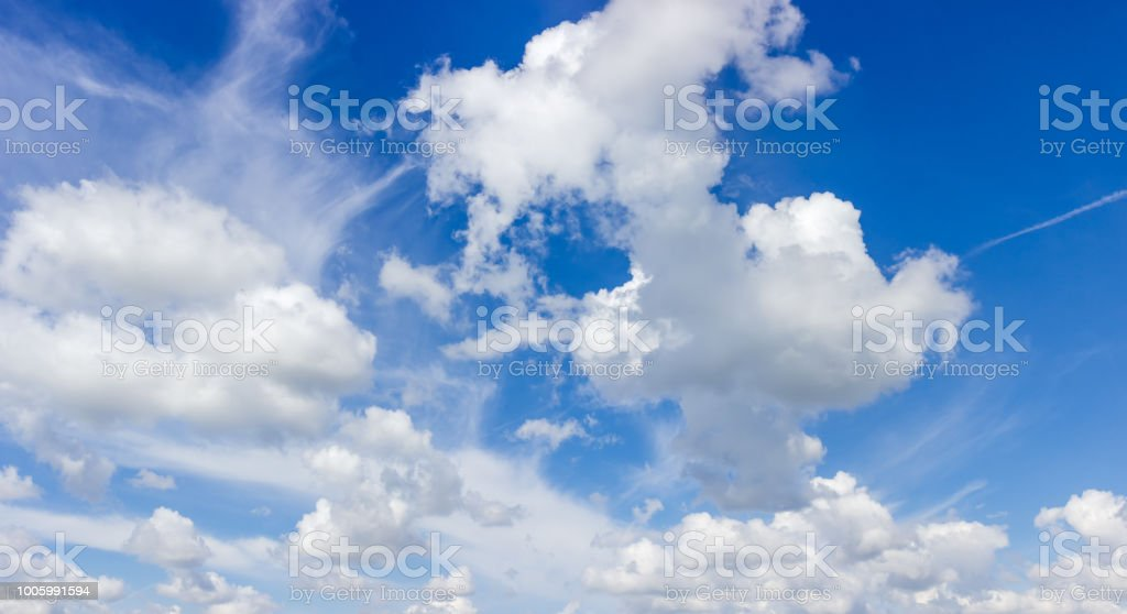 Fragment of the sky with cirrus and cumulus clouds stock photo