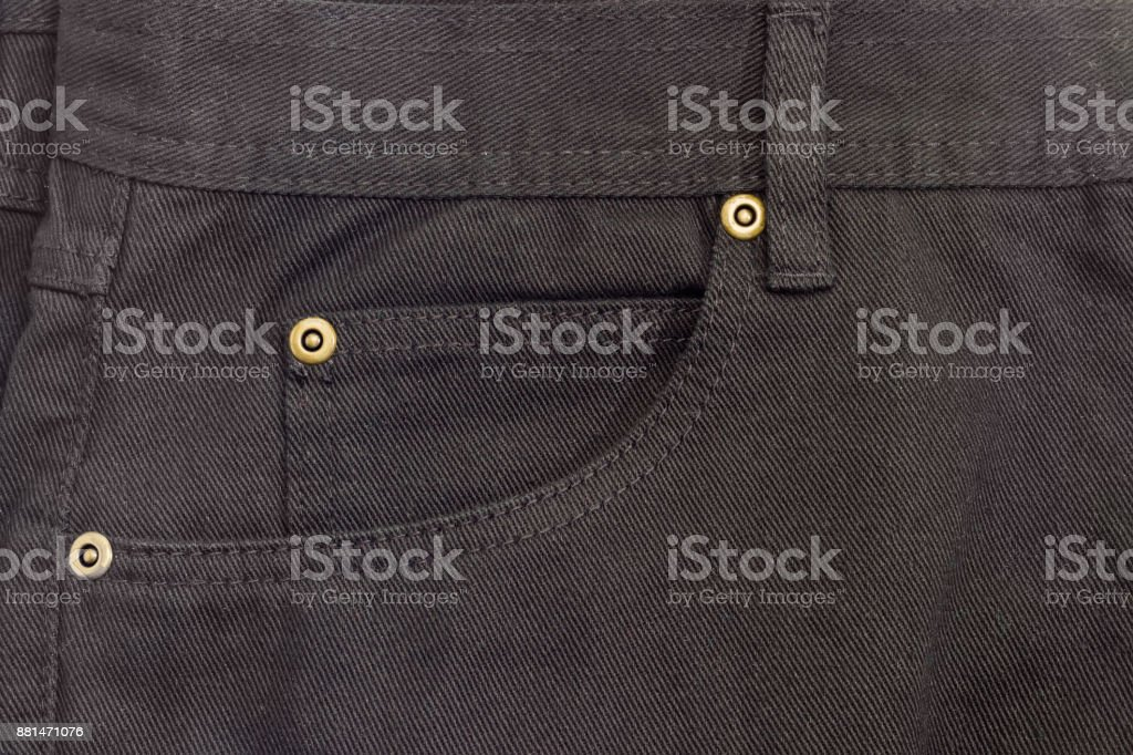 Fragment of the top of the new black jeans stock photo