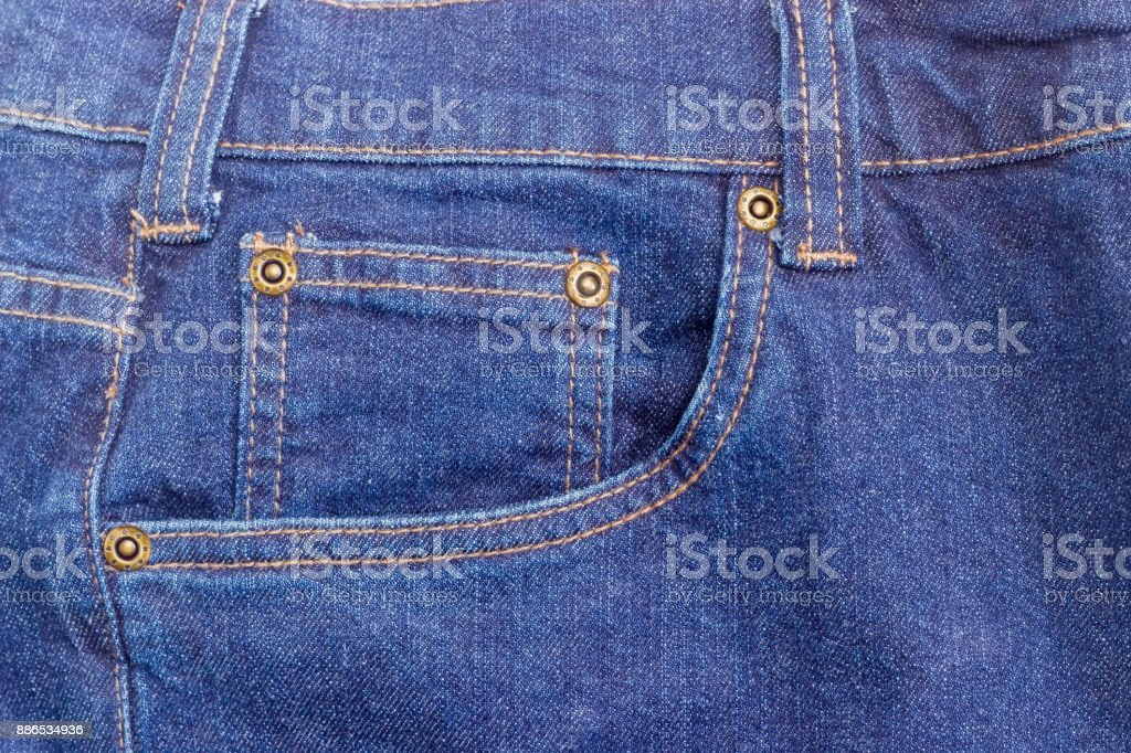 Fragment of the top of the new classical blue jeans stock photo