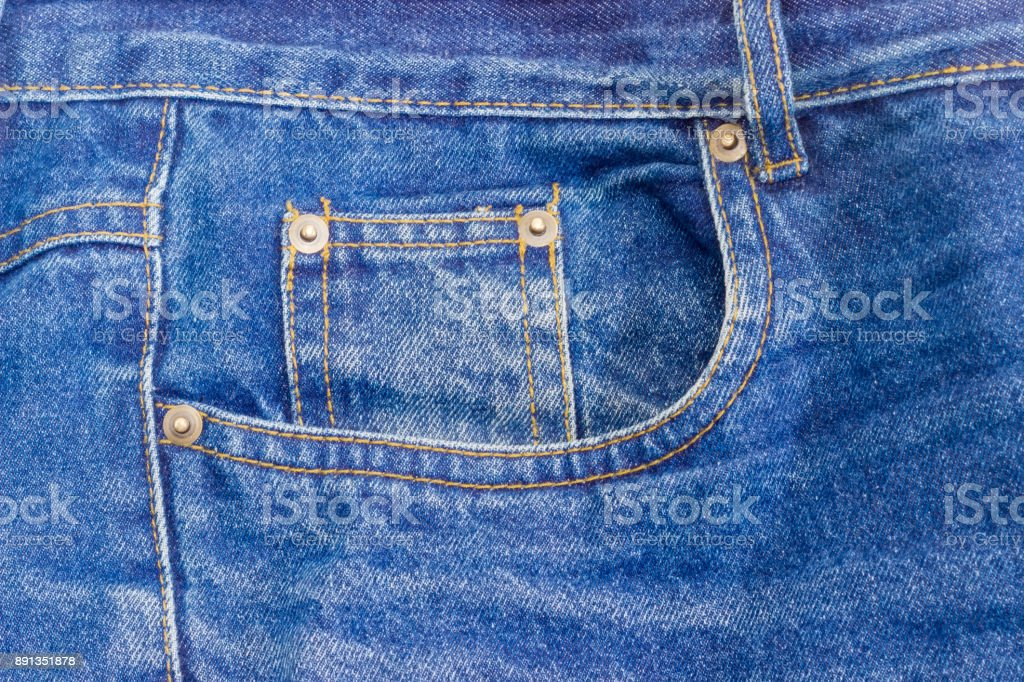 Fragment of the top of the old classical blue jeans stock photo