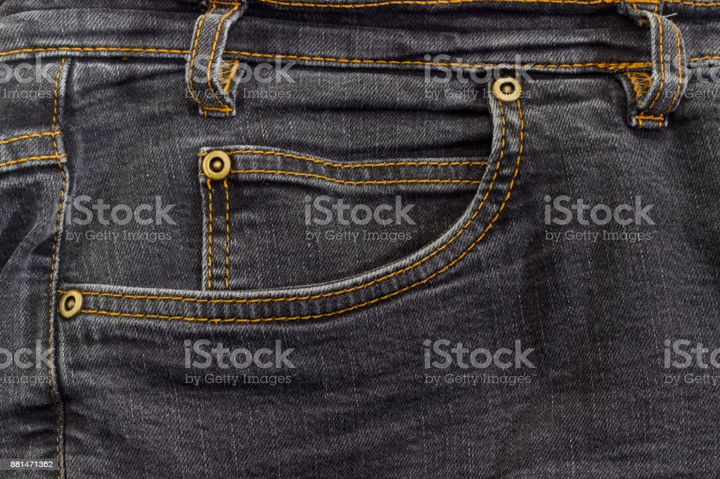 Fragment of the top of the used black jeans stock photo
