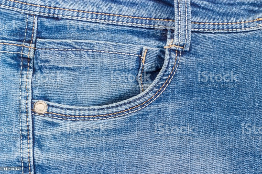 Fragment of the top of the used blue jeans stock photo