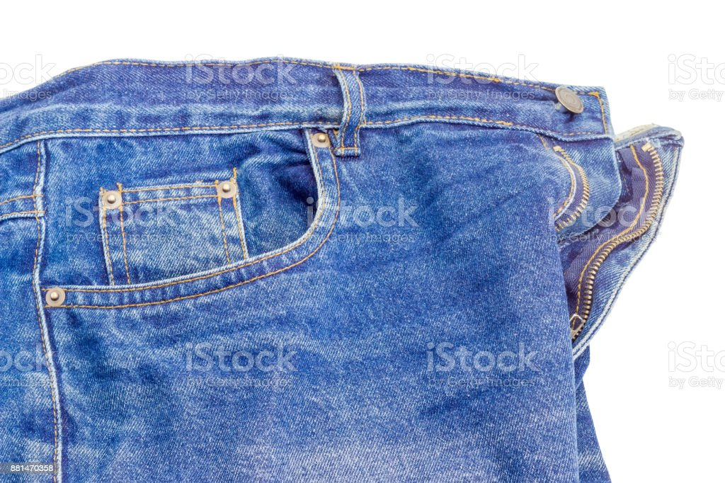 Fragment of the used classical blue jeans on white background stock photo