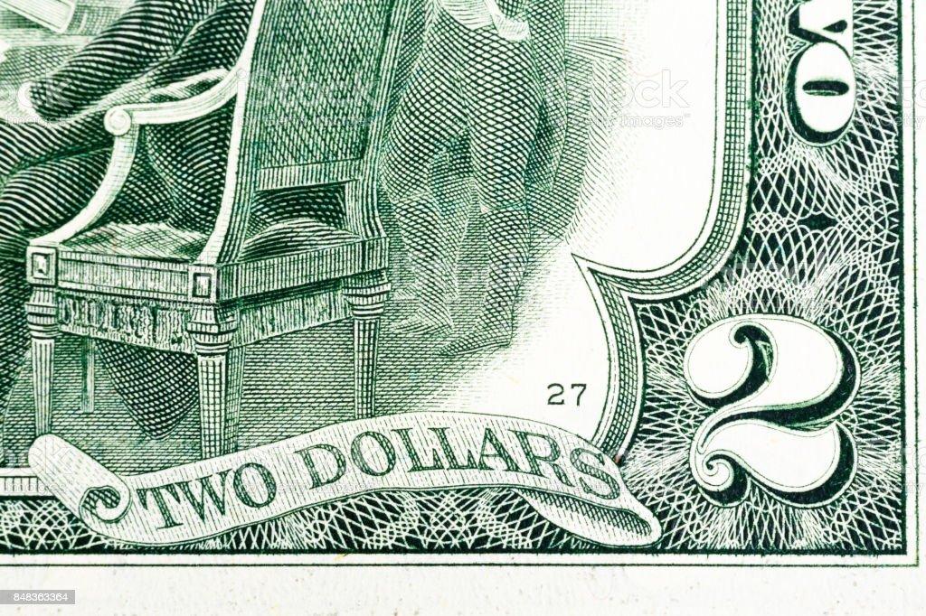 Fragment of two dollar bill. Macro shot stock photo