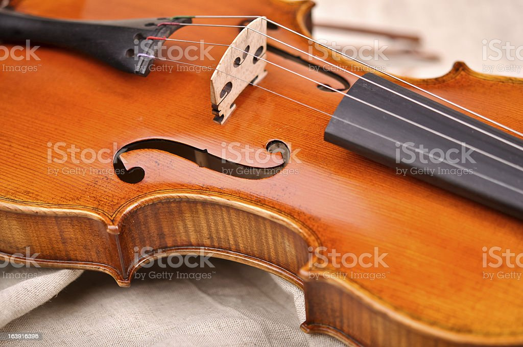 Fragment of violin isolated on beige background royalty-free stock photo