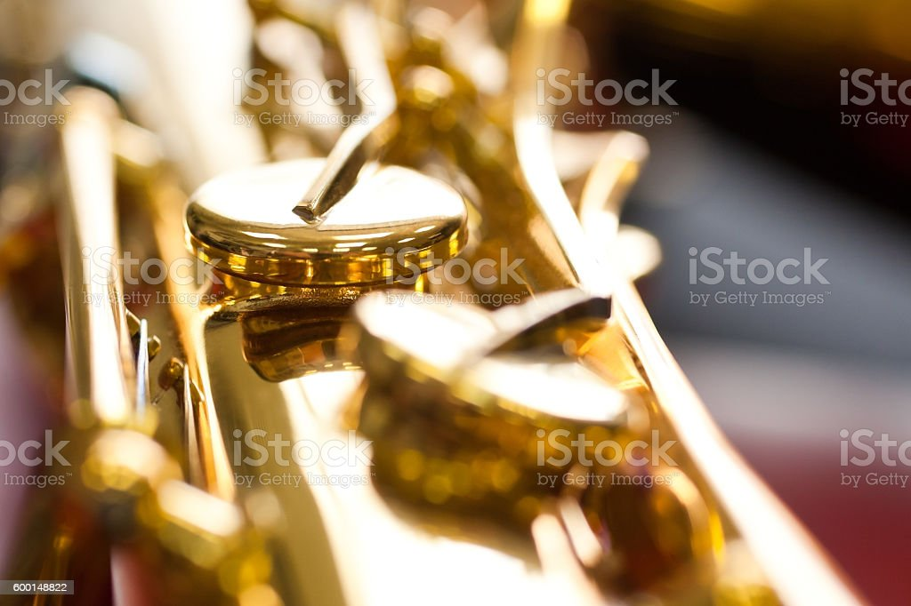 Fragment valves saxophone stock photo