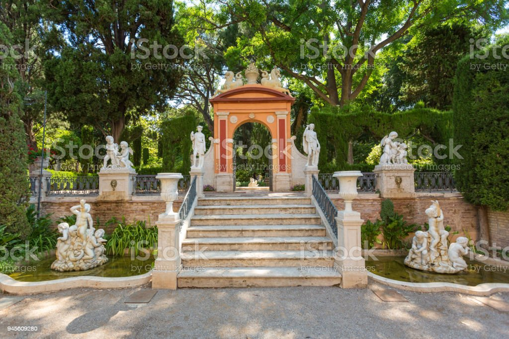 Fragments of Monforte Gardens with an arch and statue compositions in Valencia, Spain stock photo