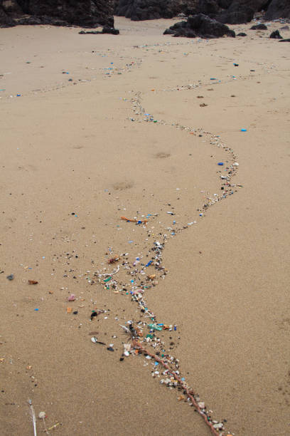 Fragments of plastic pollution washed up from the ocean. stock photo