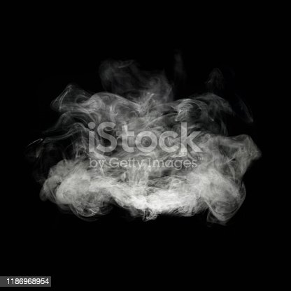 Fragrance cloud from an aromatherapy diffuser isolated on black.