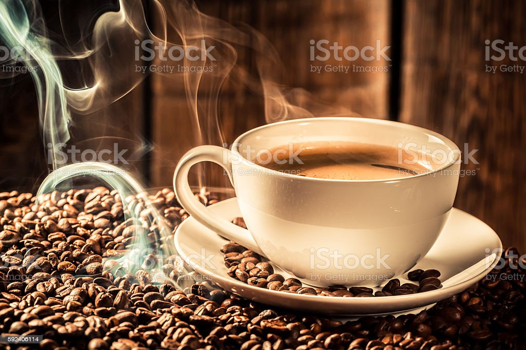 Fragrance coffee cup with roasted grains stock photo
